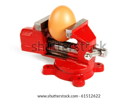 An egg in a red vice isolated on a white background