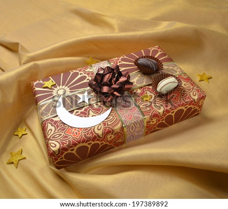 An Eid gift box and decoration - stock photo