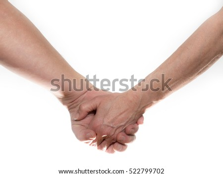 An elderly couple is holding hands