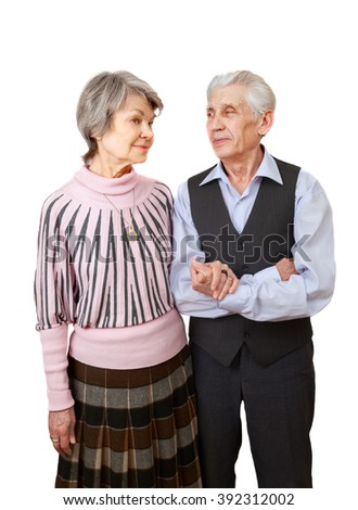An elderly couple looks at each other, isolated on white background