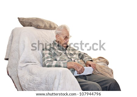An elderly disabled veteran with a concerned look on his face, sitting in an old chair reading his mail, white background with copyspace.