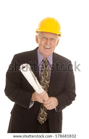 An elderly man holding on to his plans wearing his hardhat. - stock photo