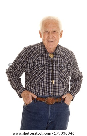 An elderly man in his western clothing with a smile on his face. - stock photo