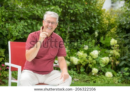 An elderly man is telling you to stop whatever you're doing! - stock photo