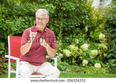 An elderly man is telling you to stop whatever you're doing while turning his head - stock photo