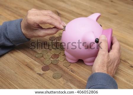 An elderly woman saves money - stock photo