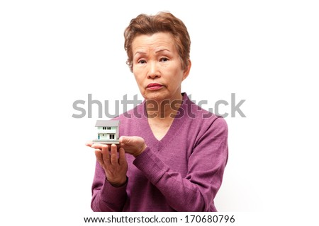 An elderly woman shot by a white background, model of housing