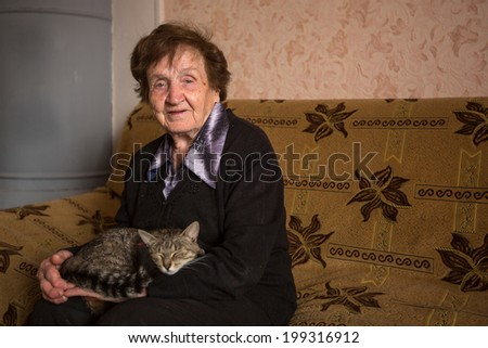 An elderly woman with cat. - stock photo