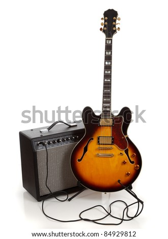 An electric guitar  and amplifier on a white background - stock photo