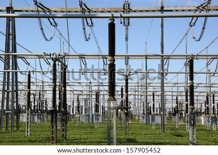 An electrical substation with transformers and resistors - stock photo