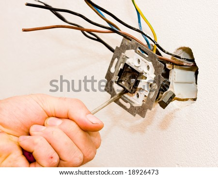 An electrician working - stock photo