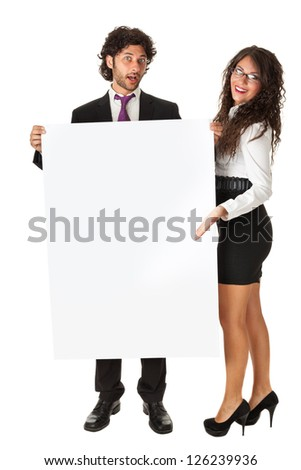 An elegant business couple holding a blank whiteboard and promoting something - stock photo