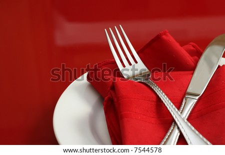 An elegant holiday table setting in red and white