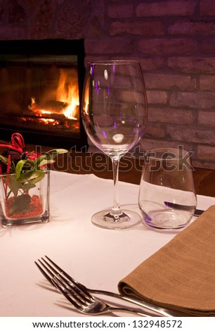 An elegant table near a fireplace - stock photo