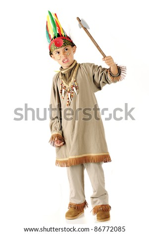 An elementary boy in costume pretending to be a vicious warrior with tomahawk.  On a white background. - stock photo