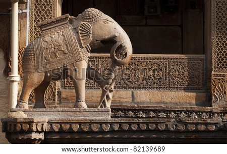 An elephant statue guards one of the structures at Jaisalmer's City in Rajasthan, India. - stock photo