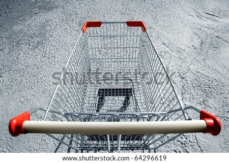 an elevated view of a single empty shopping-cart - stock photo