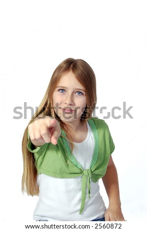 An eleven year old girl pointing her finger at you. - stock photo