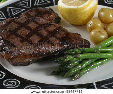 An elk steak with vegetable. - stock photo