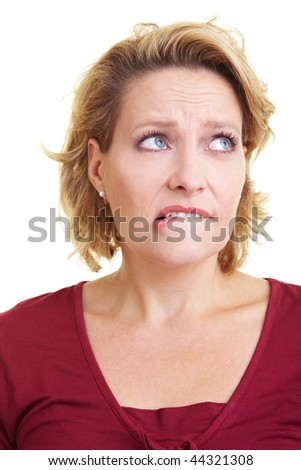 An embarrassed woman biting on her lip - stock photo