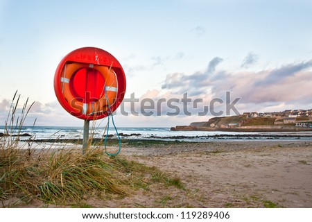 An emergency floatation device at a beach in Scotland - stock photo