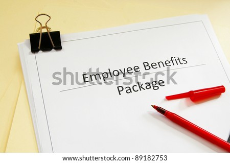 an employee benefits package and red pen - stock photo