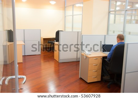 An employee in the office doing his boring job - stock photo