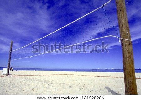An empty beach volleyball court on a clear day. - stock photo