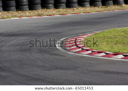 An empty bend on a race car circuit. - stock photo
