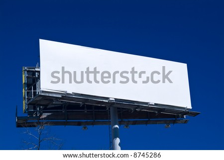 An empty billboard ready and available for advertising customers. - stock photo