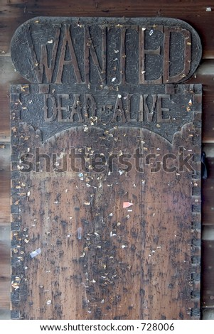 "An empty board for postings marked ""Wanted - Dead or Alive""."