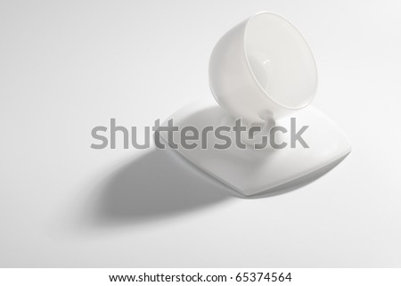 An empty coffee cup on a gray background with shadow