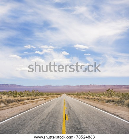An empty desert road in Mojave National Monument.