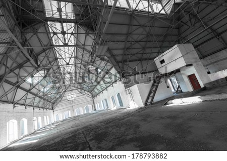 an empty desolate industrial building inside, attic - stock photo