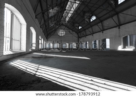 an empty desolate industrial building inside, attic - stock photo