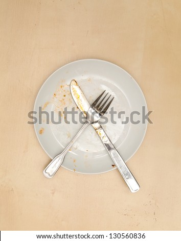 An empty dirty plate,  View from above - stock photo