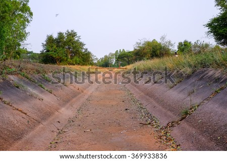 an empty ditch without water from el nino effect in Thailand - stock photo