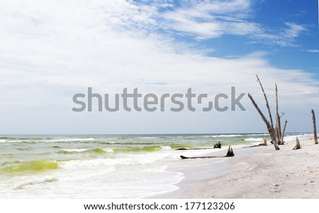 An empty florida beach on a warm summers day - stock photo