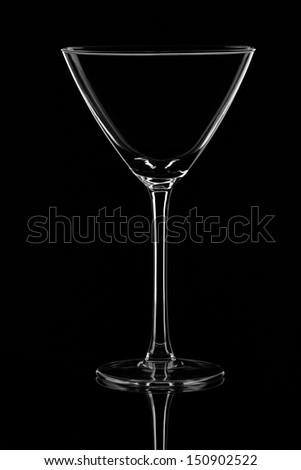 An Empty Martini Glass on Black Background - stock photo