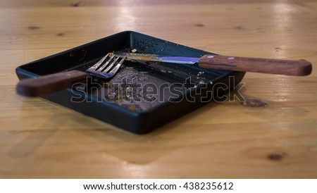 An empty plate, dirty after the meal is finished. Side view. - stock photo