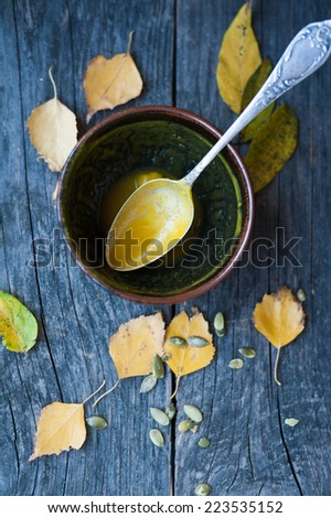 An empty pumpkin soup bowl on the table - stock photo