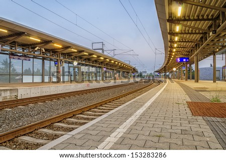 An empty railway station in evening. - stock photo