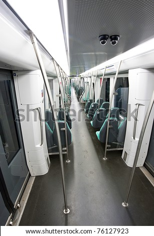 An empty subway  car, seen from the point of view of a cctv camera.