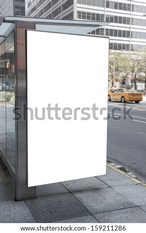 An empty white billboard at a bus stop - stock photo