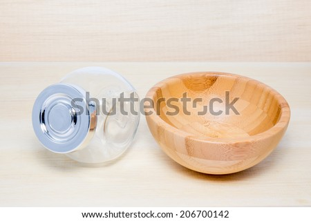 an empty wooden bowl and an empty bottle