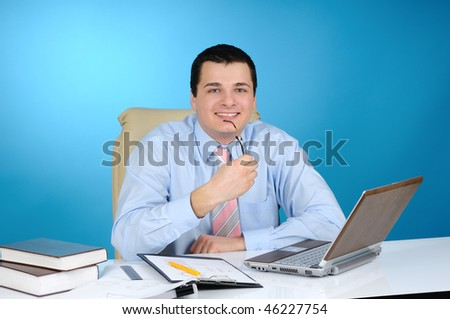 An engineer at work  on blue background - stock photo