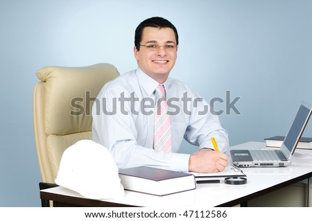 An engineer at work on gray background - stock photo