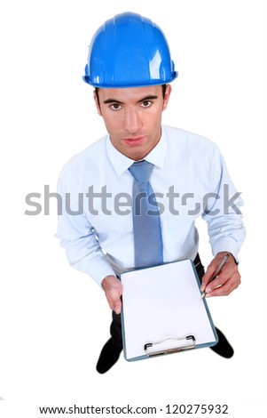 An engineer performing a check on a construction site - stock photo