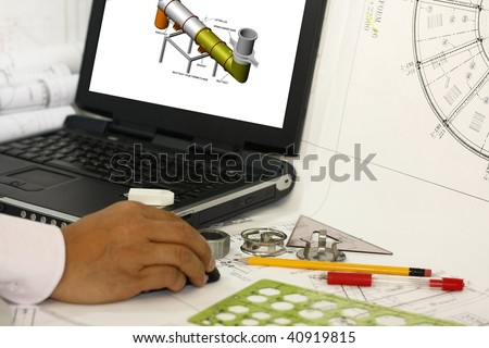 an engineer review his 3d modeling works- concept for the oil and gas industry, many uses. - stock photo