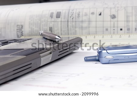 An Engineer's tools of the trade are laid out on a desktop - stock photo
